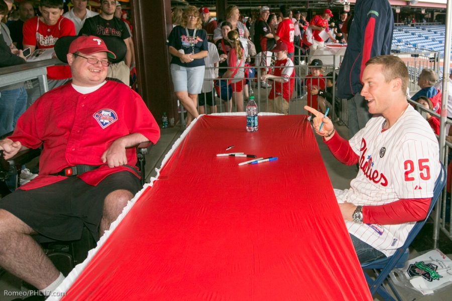 Cody Asche shares a laugh with Chuck Morris at Phillies Phestival for ALS in 2014.